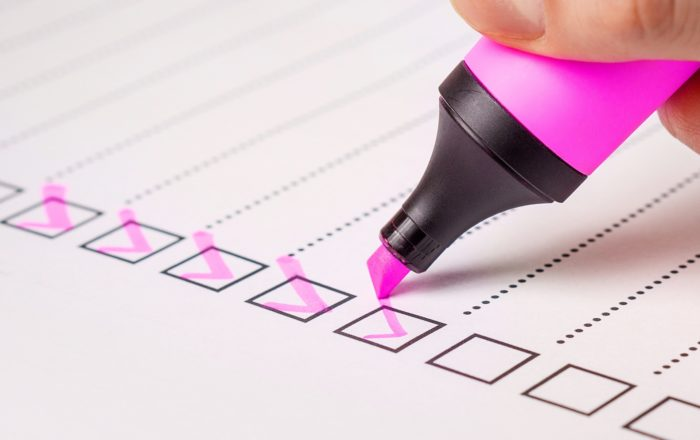 A photo of a highlighter making checklist to increase business productivity