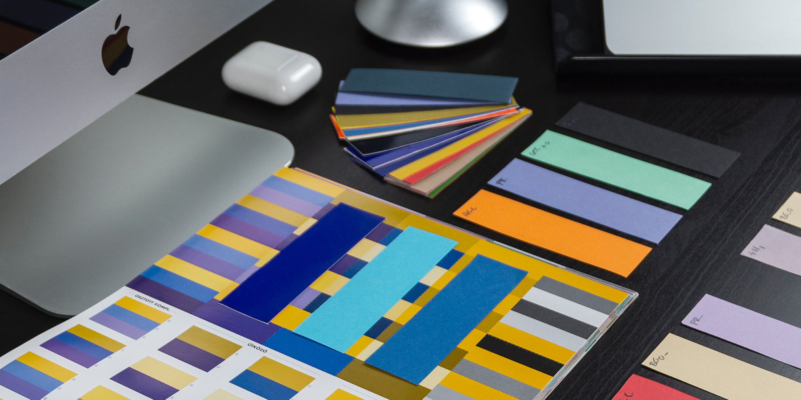 A photo of a computer table with different palettes