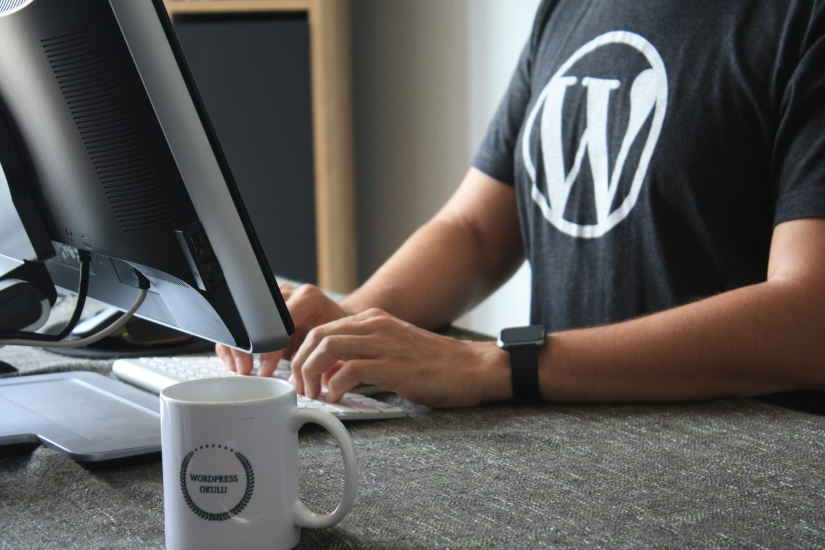 Photo of a person fixing WordPress security issues