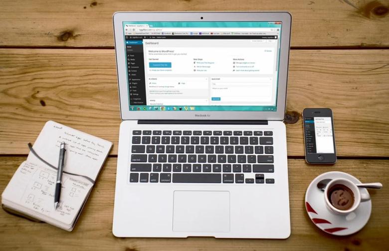 A mockup of MacBook with WordPress website